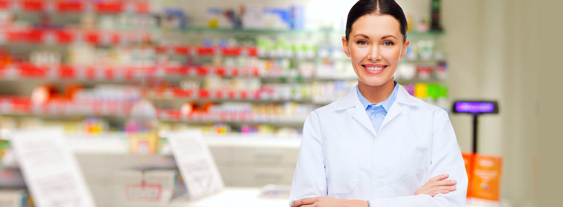 pharmacist smiling inside the drug store