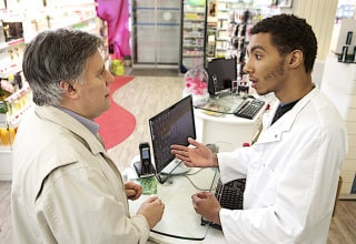 old man asking for advice to a pharmacist
